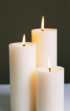 Three lighted candles